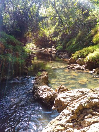 A small river with limestone on its edge. Go along the winding river in the morning.