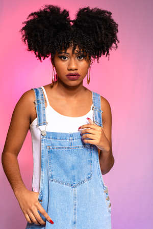 Afro Brazilian teenage model wearing an afro-style jeans gardener