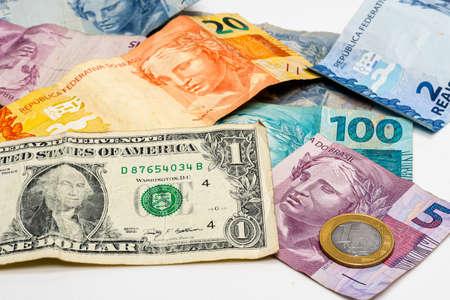 one dollar bill on Brazilian money notes, devaluation of Brazilian money Stock fotó