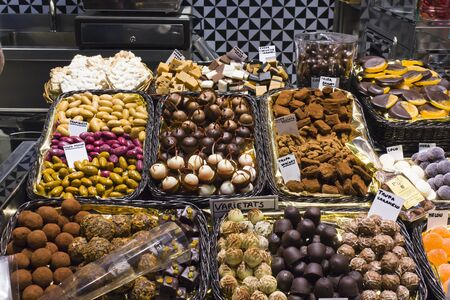 pine kernels: Variety of natural chocolates in a market in Barcelona