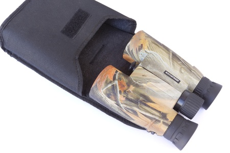 distances: Camouflage binoculars to see long distances to the target Stock Photo