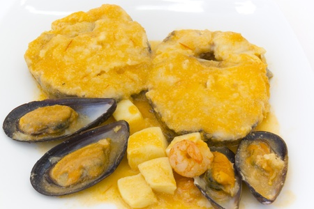hake: Hake mussels in sauce with cuttlefish and prawns  Stock Photo