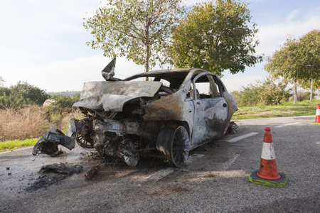 fire car: Wrecked and burning car on the road
