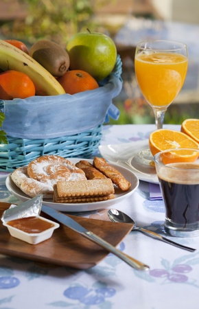 Breakfast at the table with coffee and sweet pastries photo