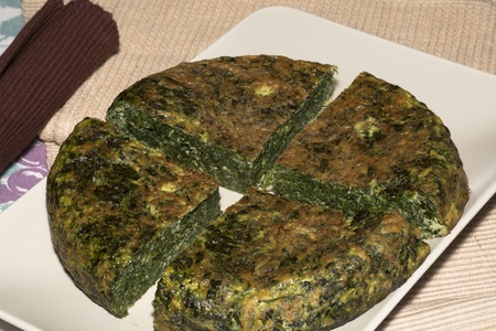 Spinach tortilla with onions and potatoes Stock Photo