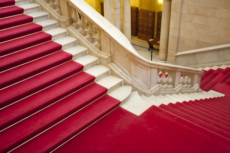Elegant marble stairs with red carpet gala