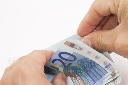 Person counting twenty euro notes Stock Photo - 12275266