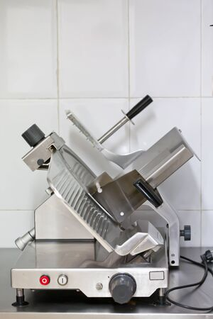 Industrial machine for cutting meats or sausages Stock Photo