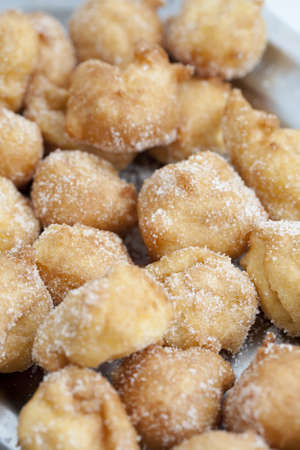 Closeup of delicious fritters with sugar lent photo