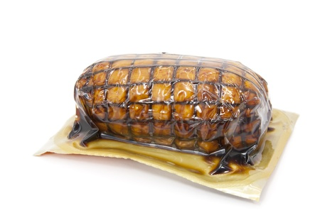 Roast vacuum packaged and tied with white background