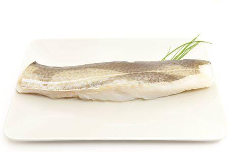 Filete de bacalao pecado cocer con el Fondo blanco Foto de archivo - 12981695