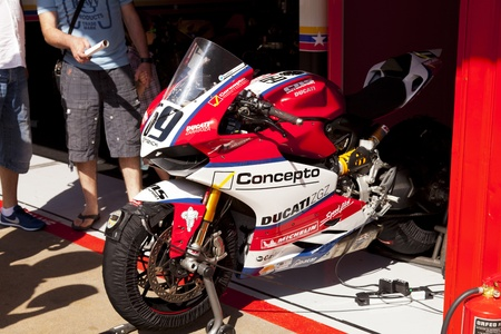 cns: BARCELONA - JUNE 24: CNS Motorsport exhibition a motorbike in the garage during Moto2 race at 2012 Speed Championship in Spain at Montmelo circuit on June 24, 2012 in Barcelona, Spain.