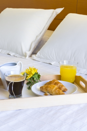 Breakfast in bed with coffee and cookies and juice Stock Photo - 14683216
