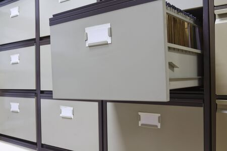 classify: Details of each open file cabinets in an office Stock Photo