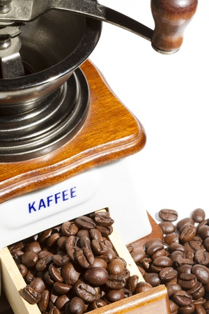 Old coffee grinder with coffee beans photo