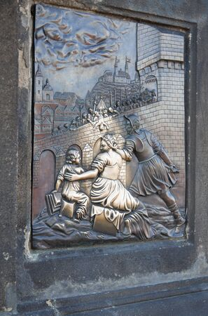 Statue on Charles bridge in Prague, Czech Republic photo