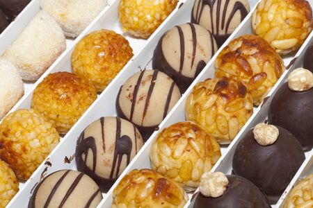 panellets: Panellets, a typical dessert of Catalonia, on the day of All Saints Stock Photo