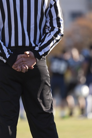 judge players: Closeup of the back of a football referee Stock Photo