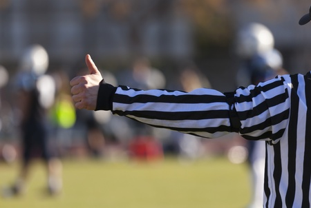 Closeup of the back of a football referee Stock Photo