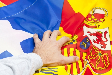 Hand picking the flags of Catalonia and Spain Stock Photo - 16917269