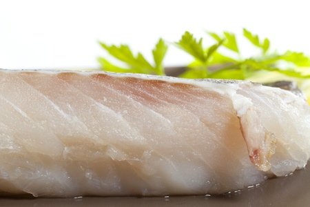 Fresh cod fillet with fresh lemon slices Stock Photo