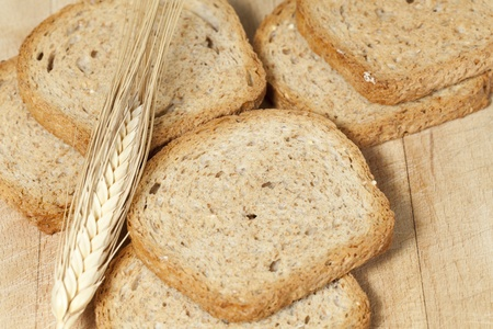 integral oven: Creaking wholemeal bread close to a spike of wheat
