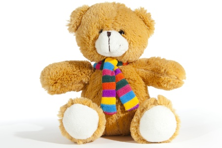 Teddy bear with scarf on a white background Stock Photo