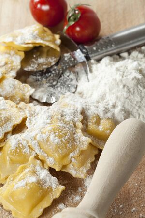 elaboration: Elaboration of delicious fresh cheese ravioli with tomato