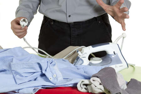 anecdote: a man ironing clothes