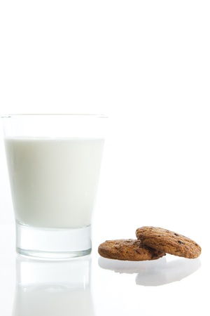 Glass of fresh milk with chocolate cookies Stock Photo - 18654525