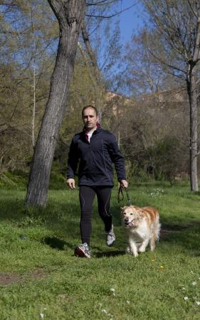 Man running with dog photo