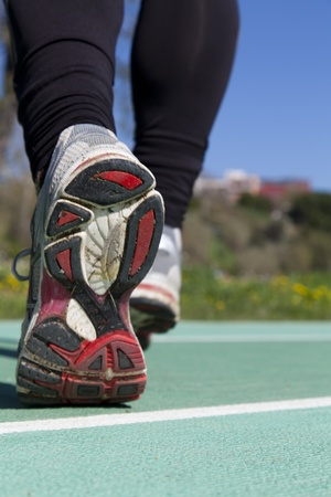 Close up of athletic sneakers on a professional track photo