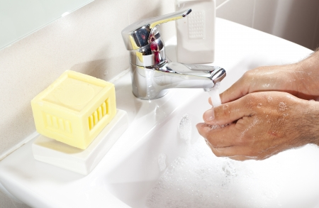 disinfectant: Washing hands with disinfectant soap in the bathroom