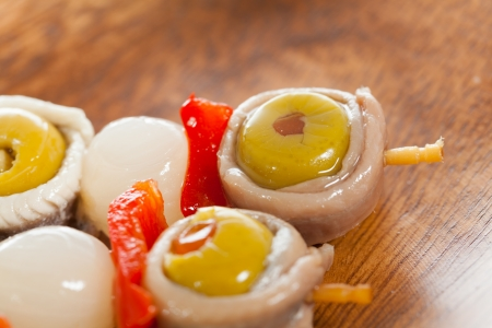 Spanish cover of boqueron, anchovies, olives, peppers and onions photo