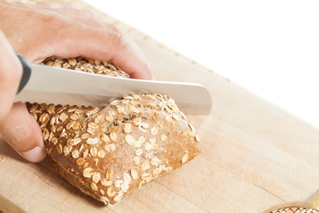 Man making a cut grain bread Stock Photo - 21598837