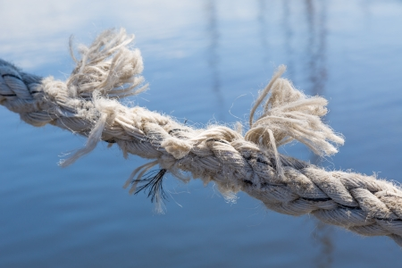 bonding rope: Boat mooring rope about to break Stock Photo