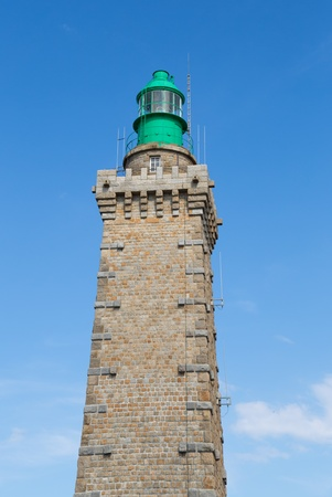 Old lighthouse on Atlantic coast in Brittany France photo