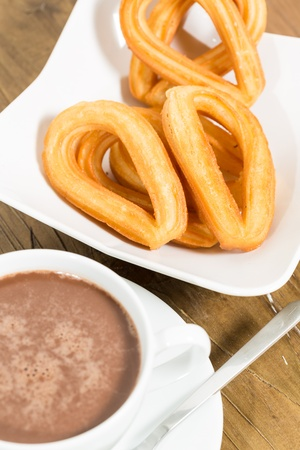 Typical Spanish dessert with chocolate with churros photo
