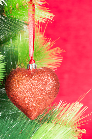 Christmas ball in the form of heart on a red background Stock Photo - 23362564