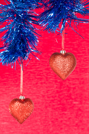 Christmas ball in the form of heart on a red background Stock Photo - 23362565