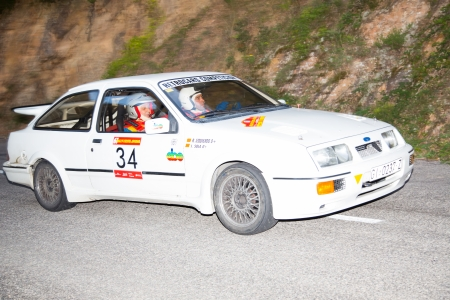 sola: Vic, SPAIN - OCTOBER  12 : Spanish driver Josep Sola and his codriver in a Ford  Sierra RS Cosworth race in the 61nd Rally Costa Brava, on October 12, 2013 in Vic, Spain Editorial