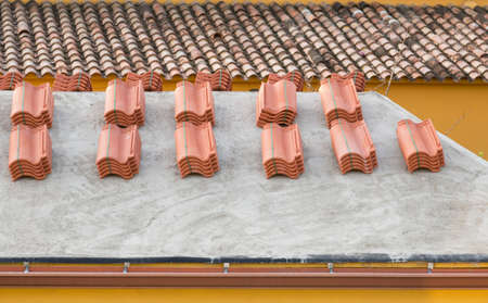 heaping: New shingles on a roof to reform