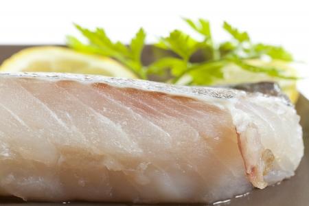 Fresh cod fillet garnished with a lemon