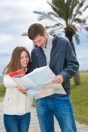astray: Tourist couple looking at a map of a street