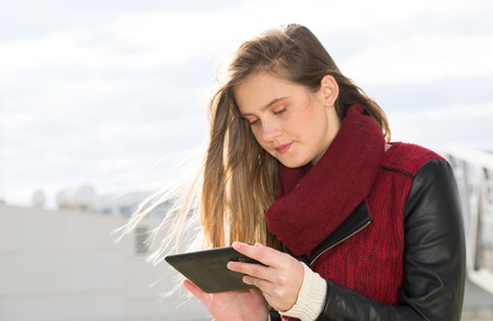 accessed: Young teenager accessed online with a tablet