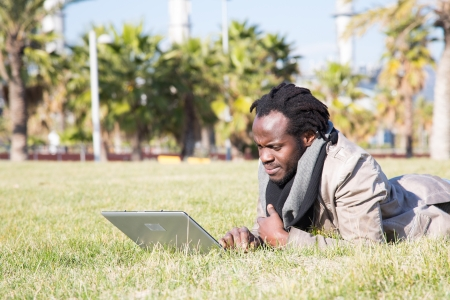 accessed: Young student accessed the internet with a laptop