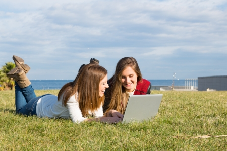 colleen: Girls in a park with a laptop at information