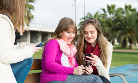 colleen: Girls gathered at the university to send mobile messages