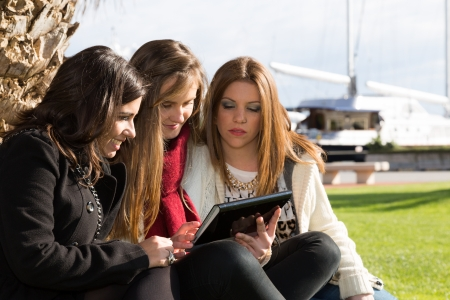 consulted: Young female students consulted on a tablet