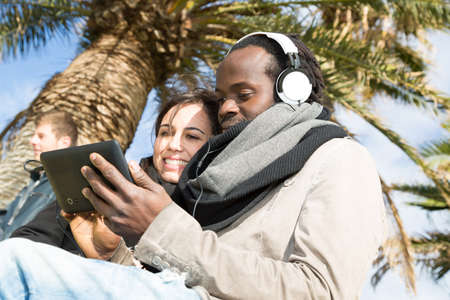 Lovers listening to music in the park photo